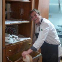 Signora Camerucci slices the bread