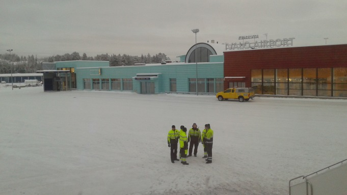 The ground crew at bustling Ivalo airport watching us depart