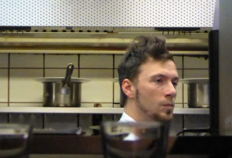 The chef peeks out through the window from the kitchen, likely due to my loud moans of pleasure