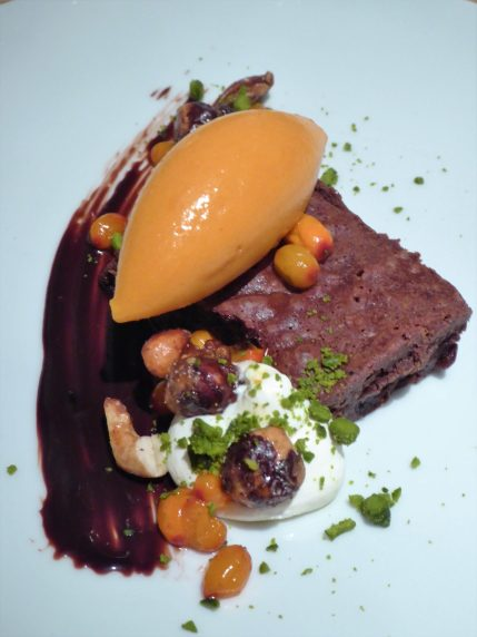 Chocolate brownie with sea-buckthorn berry sorbet and assorted garnishes