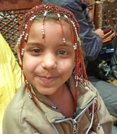 An adorable young girl, perhaps 8 years old but going on 32, who tried to sell me everything but the pyramids of Giza!
