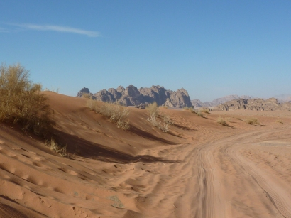 Riding in the backof a pick-up through the Wadi Rum desert preserve