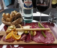 Antipasto of cheese, meat and fruits