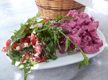Colorful red pepper and beet salads