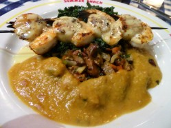 Grilled scallops and shrimp with lobster ad pumpkin sauce