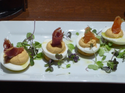 Deviled eggs with smoked ham and prosciutto