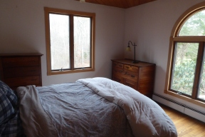 Bedroom, with windows overlooking the forest