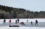 Impromptu hockey match on a frozen lake in Massachusetts