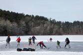 Impromptu hockey match on a frozen lake in Massachusetts