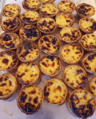 a fresh batch of pastel de nata, warm from the oven
