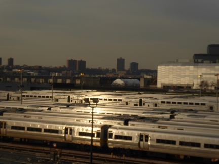 Penn Station, trains catching the last gleam of sunset