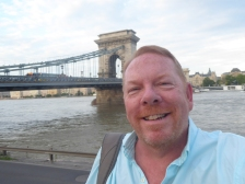 Matt in front of the Chain Bridge on the Danube