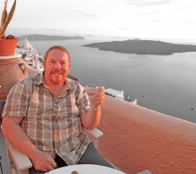 Enjoying a glass of wine from my terrace at Panorama Suites, Fira